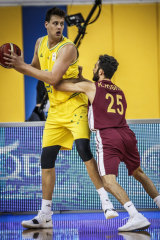 Australian big man Daniel Johnson makes the most of a mismatch in his debut against Qatar.