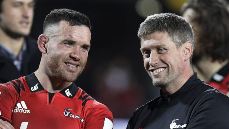 All smiles: Crusaders Ryan Crotty, left, talks with assistant coach Ronan O'Gara.