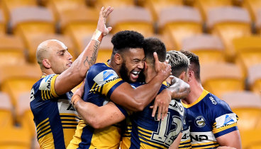 Waqa Blake celebrates his try for the Eels against the Broncos at Suncorp Stadium on Thursday night.