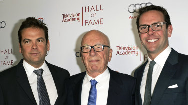 News Corp. executive chairman Rupert Murdoch, center, and his sons, Lachlan, left, and James Murdoch .