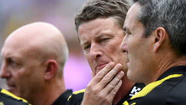 Damien Hardwick copped an abusive text message from his son for dropping Higgins.
