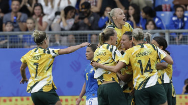 Australia's players celebrate after Chloe Logarzo scored their side's second goal.