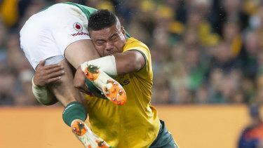 Upper-body strength: Tolu Latu manhandles Rob Kearney.