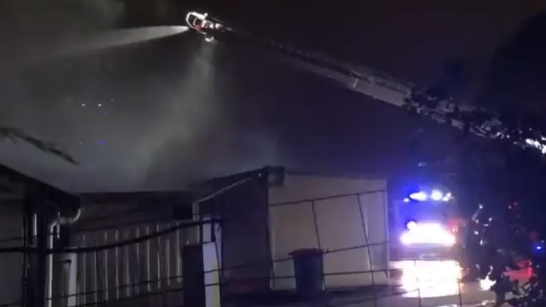 The factory at Geebung going up in flames.