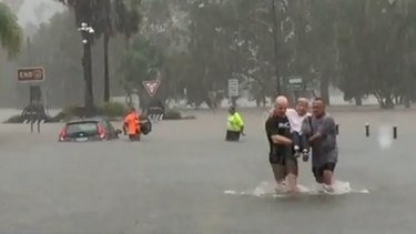 Adam Bailey and Alan Blanch, co-owners ofNorthern Rivers Collectables, helped save an elderly woman from drowning in floodwaters in Lismore on Wednesday.