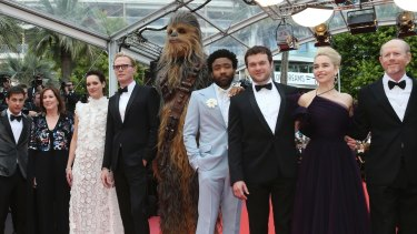 Producer Kathleen Kennedy, Phoebe Waller-Bridge, Paul Bettany,  Chewbacca, Donald Glover, Alden Ehrenreich, Emilia Clarke and director Ron Howard at the Cannes premiere of Solo: A Star Wars Story.