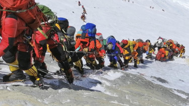 A queue of climbers line a path on Mount Everest this year.