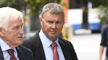 Dave Hanna, a former CFMEU Queensland secretary, walking to court on the opening day of a trial following an alleged incident at a woman's home after the pair met outside a bar in Brisbane's Fortitude Valley in March last year.