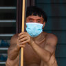 A Yanomami man awaits medical attention during the coronavirus pandemic in Alto Alegre, Roraima, Brazil. Indigenous representatives say 405 tribespeople have died of COVID-19 in the Amazon, and more than 9000 have been infected.