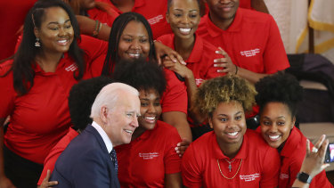 Democratic presidential candidate and former vice-president Joe Biden takes a picture with the choir at the Brown Chapel African Methodist Episcopal Church in Selma, Alabama.