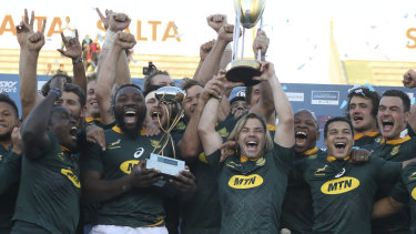 Breakthrough: The Springboks enjoy claiming the Rugby Championship trophy, their first major title in a decade.