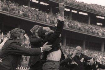Ron Barassi celebrates Carlton's comeback victory in the 1970 grand final.