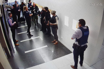 Victoria Police and Australian Border Force officers raid Frank Hu's Melbourne office in 2019.