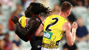Richmond player Dylan Grimes (right) and Essendon's Anthony McDonald-Tipungwuti in the controversial game in Darwin last year.