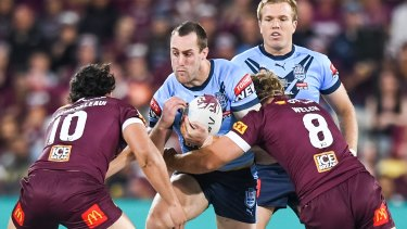 Isaah Yeo charges into the Queensland defence during the State of Origin series opener.