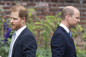 Prince Harry, left, and Prince William stand together during the unveiling of a statue they commissioned of their mother Princess Diana, on what woud have been her 60th birthday.