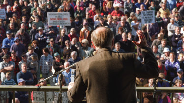 Then prime minister John Howard wears a bullet-proof vest at a rally in Sale in June 1996 to argue for gun restrictions in the wake of the Port Arthur massacre.