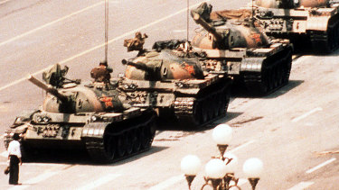 A lone protester clutching a shopping bag prevents a line of tanks from reaching Tiananmen Square on June 4, 1989.