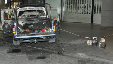 Crime scene photos show the gas bottles pulled from the burnt-out ute.