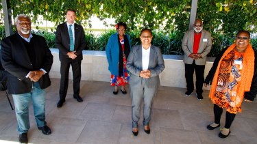 Member for Cook Cynthia Lui (front row, centre) with Minister for Aboriginal and Torres Strait Islander Partnerships Craig Crawford (back row, left) with Torres Strait Islander representatives in Brisbane on Thursday.
