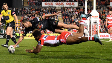 Back to the future: Brent Naden scores a try at Panthers Stadium.