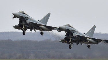 Two Eurofighter jets perform at the German Air Force Base in Noervenich, western Germany.