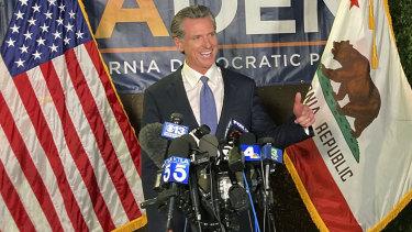 California Governor Gavin Newsom addresses a crowd in Sacramento on Tuesday night, US time.