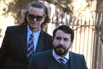 Charles Waterstreet, left, arrives at the murder trial of Roger Rogerson and Glen McNamara in 2015.