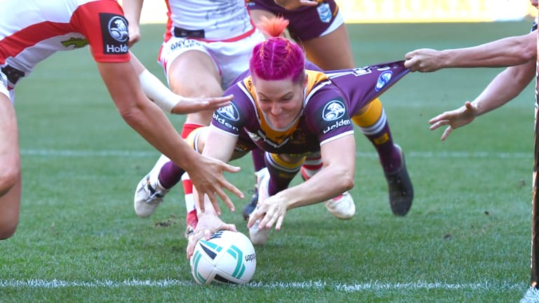 In the pink: Chelsea Baker scores for the Broncos in their opener against St George Illawarra on Sunday.