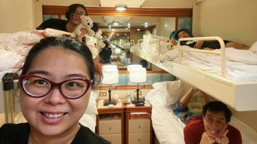 In for the long haul: Australian woman Aun Na Tan and her family in their cabin on board the Diamond Princess, which has been docked in quarantine in Yokohama due to the coronavirus outbreak.