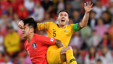 Committed: Mark Milligan lined up at centre back against South Korea in his first game as full-time skipper.