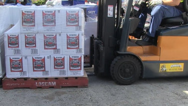 Alcohol is loaded onto a truck.