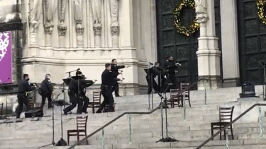 New York police officers move in at the Cathedral Church of St John the Divine.