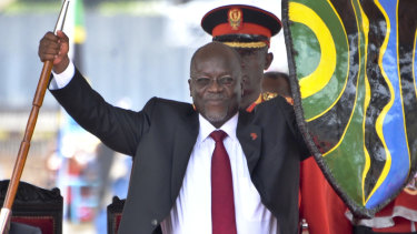 Tanzania's John Pombe Magufuli holds up a ceremonial spear and shield to signify the beginning of his presidency in 2015.