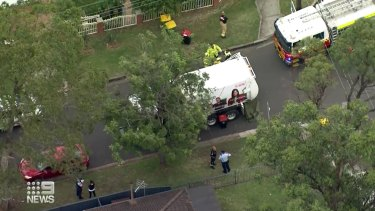 A woman has died after she was struck by a garbage truck in Sydney's west on Tuesday.