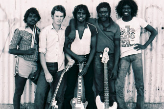 The Warumpi Band in Papunya in 1981, from left, Gordon Butcher, Neil Murray, Sammy Butcher, Denis Minor and George Rrurrambu (deceased).