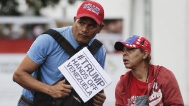 """Supporters of Venezuela's President Nicolas Maduro attend an """"anti-intervention"""" march on Wednesday."""