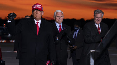 Mark Meadows, pictured on the right, is seen with Trump and Mike Pence at a campaign rally on November 2.