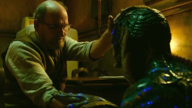 Richard Jenkins, left, and Doug Jones in a scene in The Shape of Water.