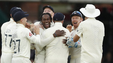 Jofra Archer, centre, celebrates after taking the wicket of Cameron Bancroft.