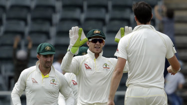 Tim Paine celebrates a wicket.