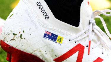 Feet first: Tim Cahill's personalised boots for the World Cup.