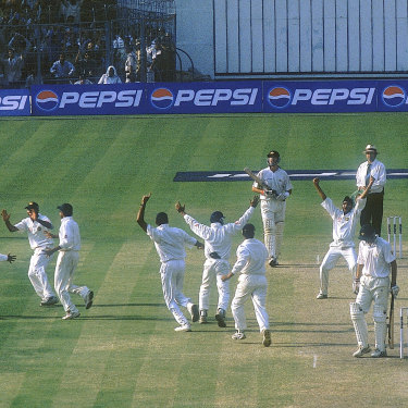 India celebrate the wicket of Jason Gillespie as they close in on victory at Eden Gardens