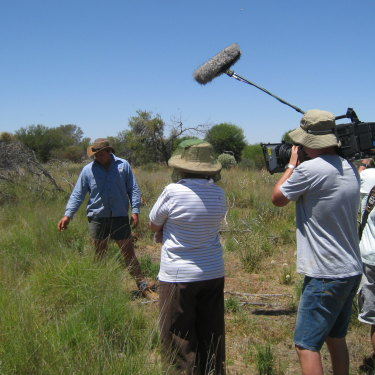Pollock tries to pass on his passion for perennial grass to a TV film crew.