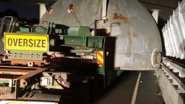 The wide load on the truck shifted, causing it to become wedged.