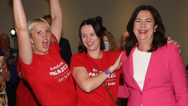 Premier Annastacia Palaszczuk, right, celebrates her election win with her sisters Julia and Nadia.