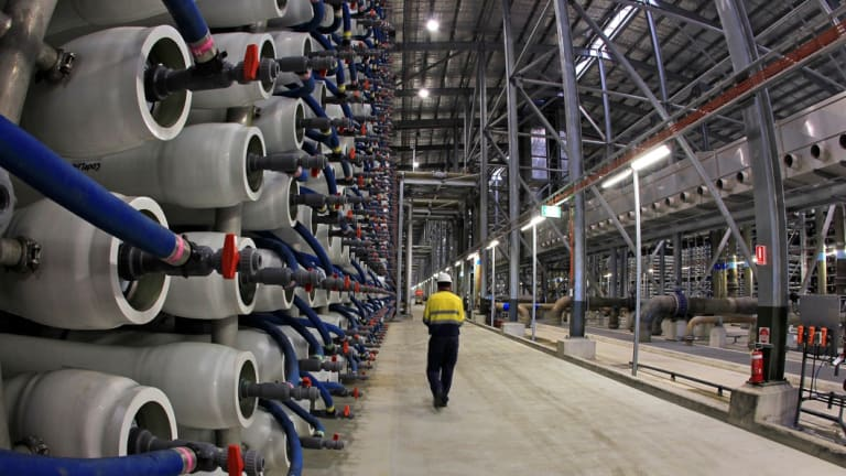 An employee of the Sydney Desalination plant walks past some of its 36,000 polymer membranes used to filter salt and other impurities from seawater so that it is suitable for drinking.