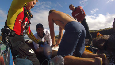 Lifesavers try to revive the man.