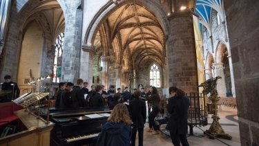 The music tour choir performing at St Giles Cathedral on the Royal Mile, in Edinburgh.