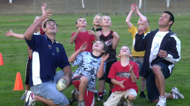 Sean Maloney among the Rams under-8s alongside Terry Campese (left) and Lincoln Withers (right)